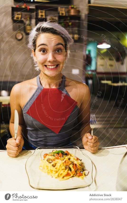 Content woman having meal Woman Plate Happiness Emotions Food Gourmet Grimace Dinner having fun Easygoing Hold Lunch pretend Preparation Café Dish