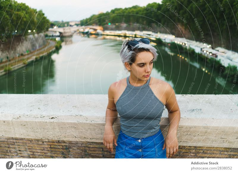 Young confident woman posing on bridge Woman Posture Self-confident Style romantic Summer Downtown Beauty Photography Tourism Natural Town Leisure and hobbies