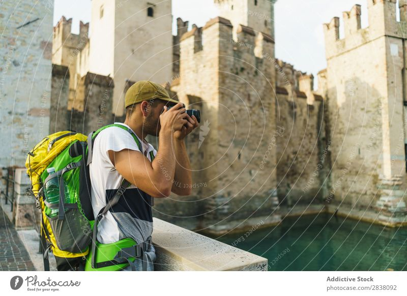 Tourist taking photo of sight Man Traveling backpacker Town Memory Photographer Castle City Lifestyle Technology Easygoing Photography Camera Summer