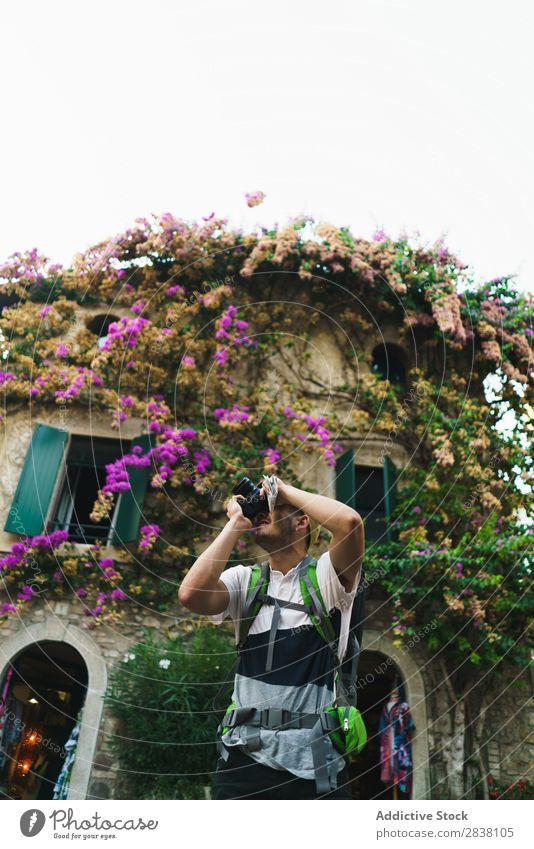 Man taking photo of surroundings in city backpacker Tourist Town Memory romantic Photographer Camera Street Traveling City Lifestyle Technology Easygoing