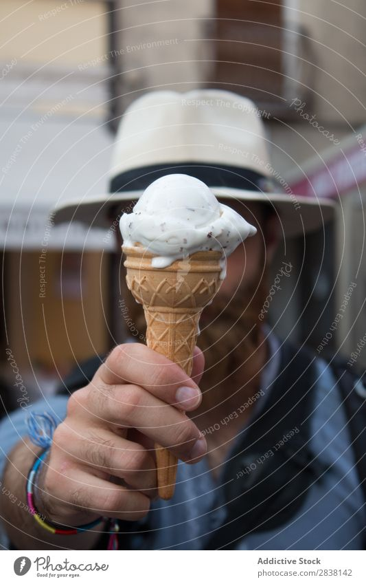 Man covering face with ice-cream Joy Posture obsession human face traveler Snack Youth (Young adults) Easygoing Leisure and hobbies Expression Emotions Dessert