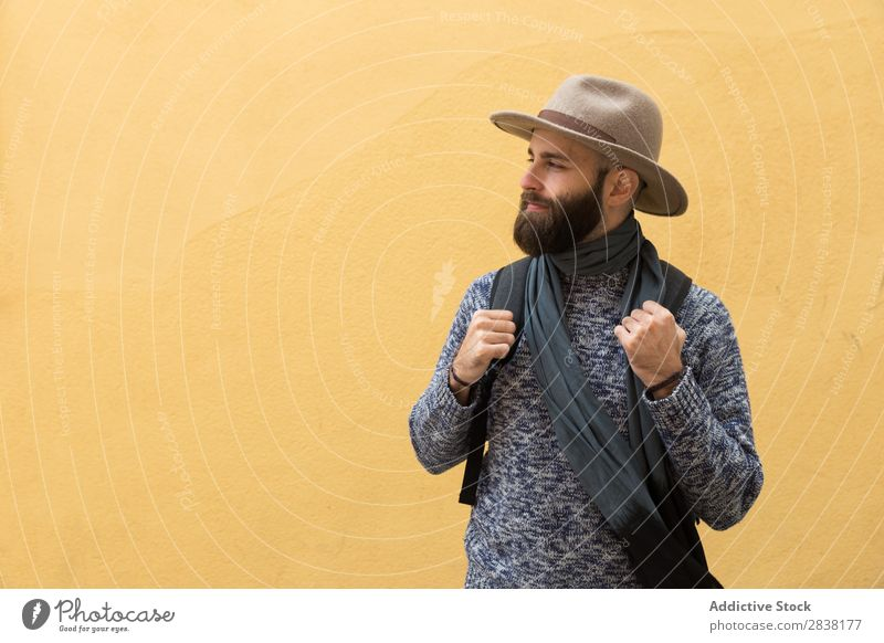 Tourist at yellow wall Man Backpack Wall (building) Yellow Looking away Youth (Young adults) Vacation & Travel Tourism Human being Guy Trip bearded Hat handsome
