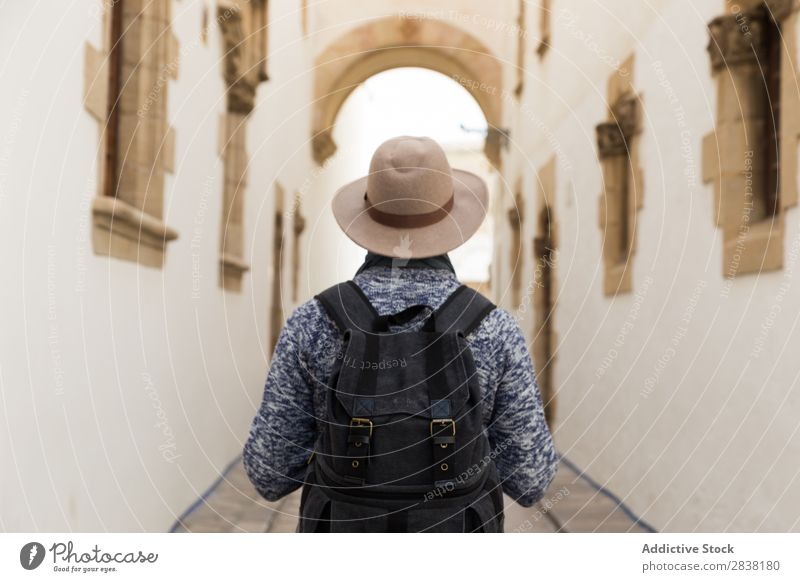 Man with backpack in the street Backpack Street Stand Hat City Lifestyle Human being Vacation & Travel Town Tourist Trip Style traveler Easygoing Alley