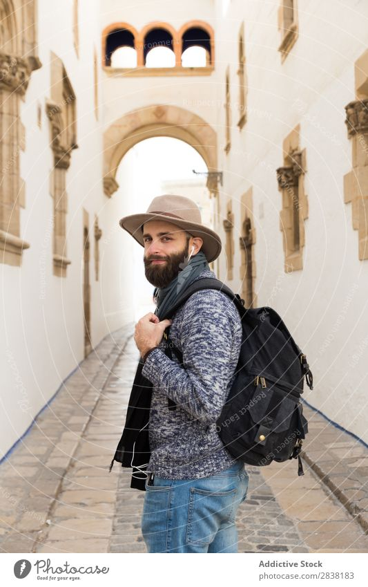 Tourist looking back on alley Backpack Street Looking back Headphones Hat bearded handsome Trip Vacation & Travel Alley City Youth (Young adults) Town Lifestyle