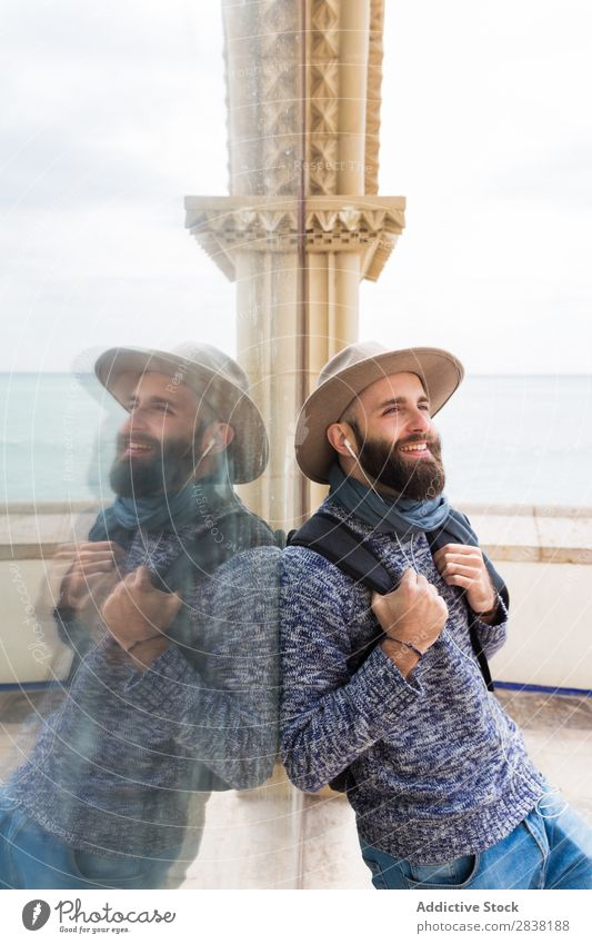 Cheerful bearded man with headphones Man Headphones Style Looking away Smiling Vacation & Travel Tourist Happy Portrait photograph Stand Music