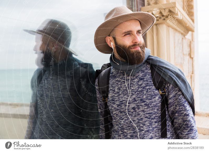 Cheerful bearded man listening to music Man Headphones Style Looking into the camera Contentment Portrait photograph Stand Music Youth (Young adults) Lifestyle