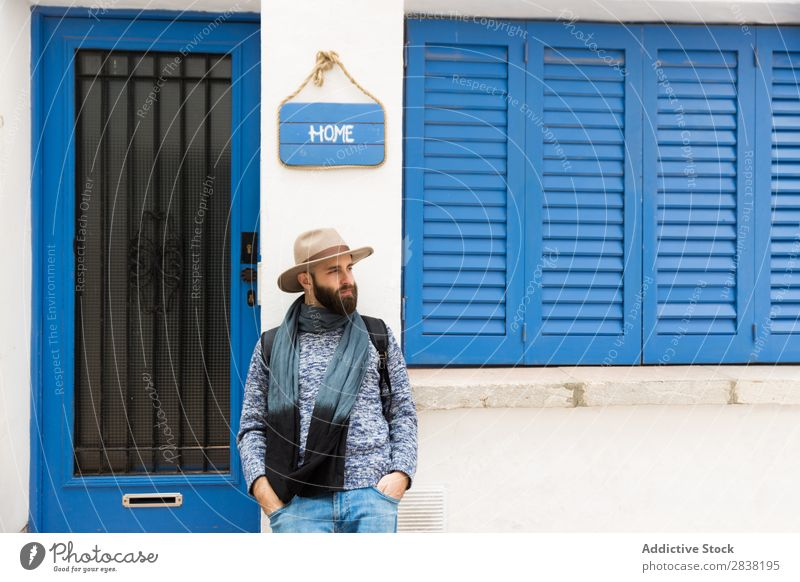 Man standing at home sign Style Street Home Plate Sign Posture Looking away Human being bearded handsome Hat Youth (Young adults) Portrait photograph Town