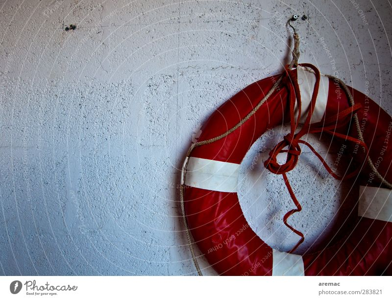 Rescue approaches Wall (barrier) Wall (building) Facade Old Retro Round Red White Safety Protection Dangerous Life belt Garage Colour photo Subdued colour