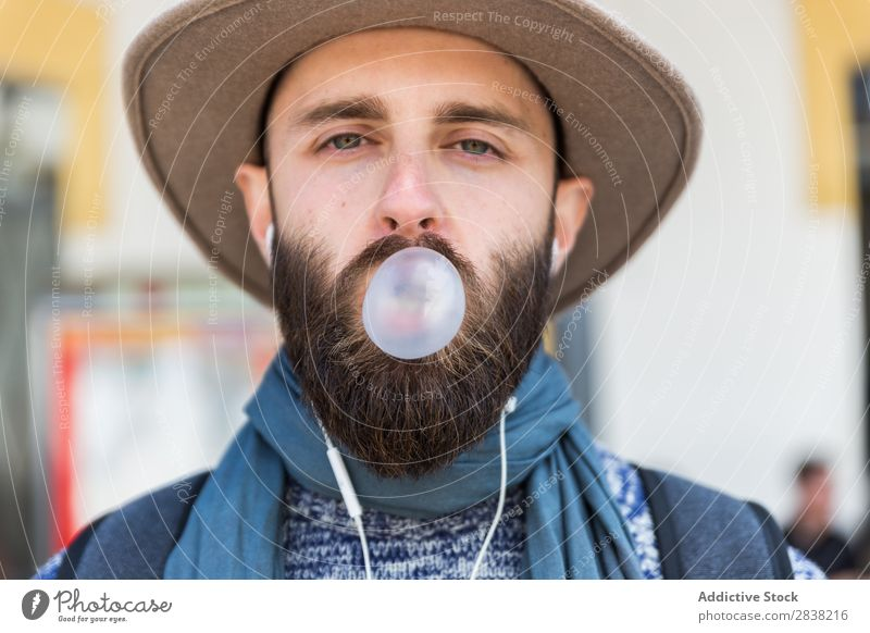 Stylish man chewing a gum Man Gum Chew Bubble Blow Looking into the camera Close-up Face Portrait photograph Youth (Young adults) Chewing gum Fresh Expression