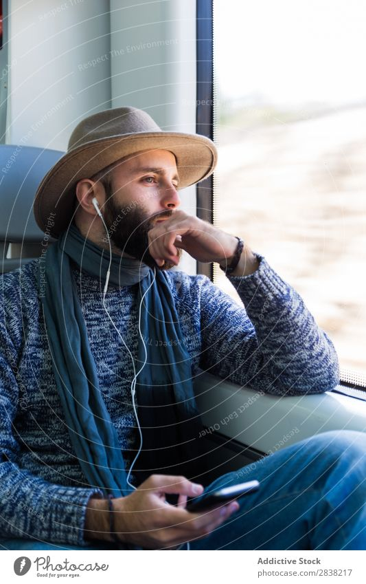 Man listening music in train Railroad Music Listening Vacation & Travel Youth (Young adults) Looking away Headphones Beard Transport Sit Passenger Modern