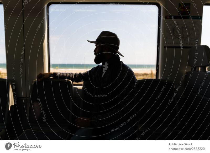 Silhouette of man in train Man Ride Railroad Hat Beard Vacation & Travel Transport Human being Passenger Trip traveler Seat wagon Sit Vehicle Speed Tourist