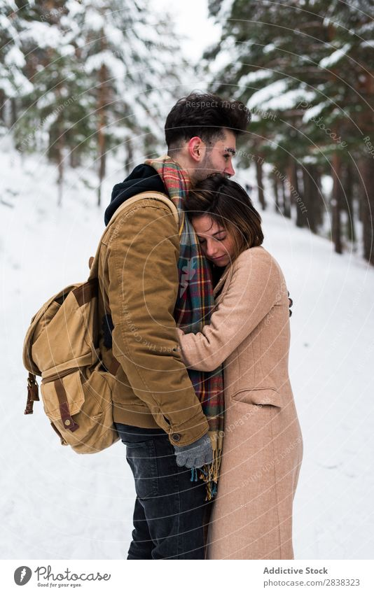 Couple embracing in forest Winter Forest Together Relationship Beautiful romantic Snow White Youth (Young adults) Love Romance Affectionate Family & Relations