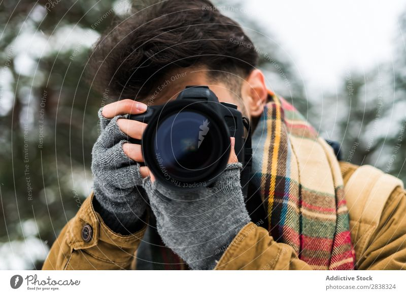 Male photographer taking shot Man Winter Photographer Equipment Photography Relaxation Shot Lens photocamera Leisure and hobbies Photo shoot