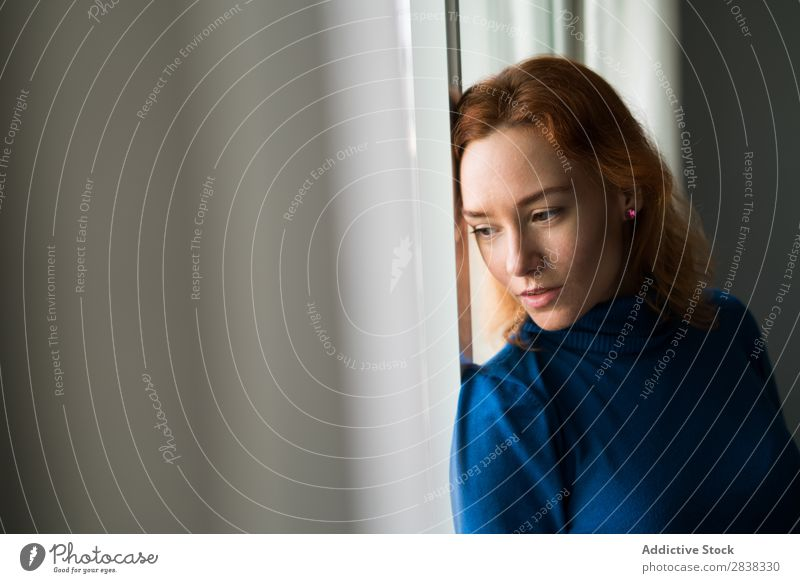 Pensive woman at the window Woman pretty Considerate Window Stand Beautiful Red-haired Youth (Young adults) Attractive Human being Girl Portrait photograph
