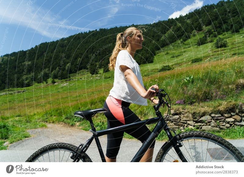 Pretty woman with bicycle Woman Athletic Bicycle Smiling Cheerful Sports Cycle Girl Action Lifestyle Cycling Human being workout Mountain Motorcycling