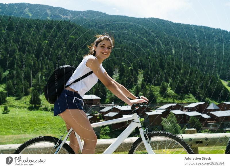 Woman riding bike Athletic Bicycle Cheerful Smiling Looking into the camera Sports Cycle Girl Action Lifestyle Cycling Human being workout Mountain Motorcycling