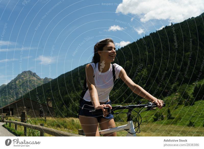 Woman riding bike Athletic Bicycle Cheerful Smiling Sports Cycle Girl Action Lifestyle Cycling Human being workout Mountain Motorcycling Relaxation Asphalt