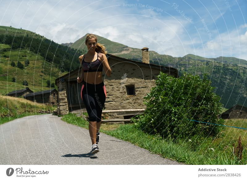 Woman jogging in countryside Street Jogging Rural Athletic Youth (Young adults) Fitness Practice Athlete Sports Landscape workout Leisure and hobbies Action