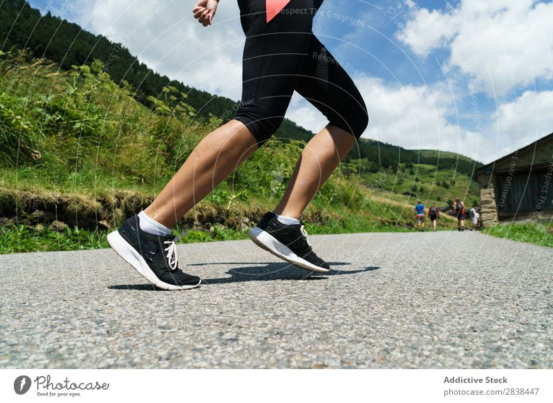 Crop woman jogging in countryside Woman Jogging Rural Fence Grass Athletic Youth (Young adults) Fitness Practice Athlete Sports Landscape workout