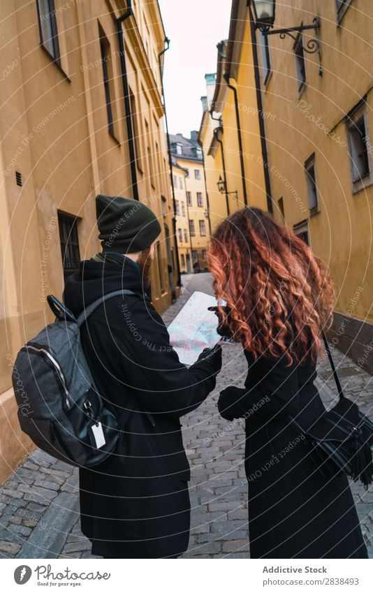 Couple with map on street Street Happy City Human being Map Navigation Vacation & Travel