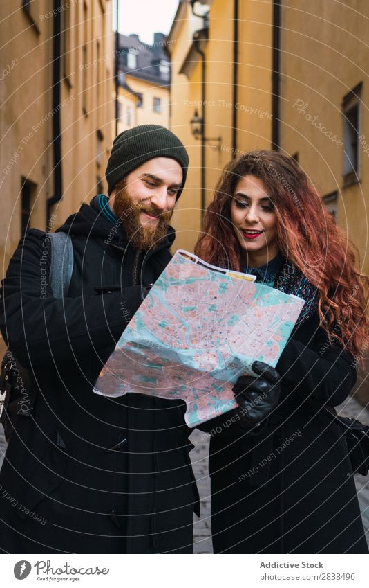 Couple with map on street Street Happy City Human being Map Navigation Vacation & Travel Tourism Love Happiness Relationship Cheerful Youth (Young adults) Man