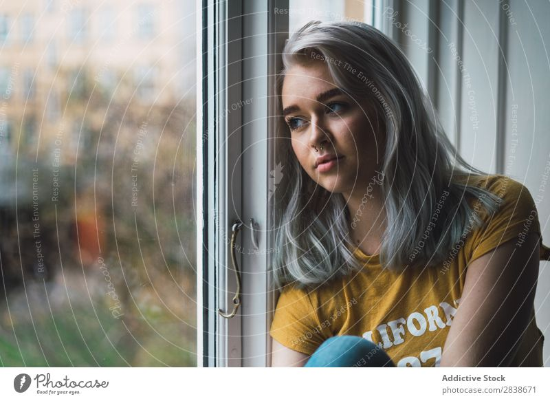 Thoughtful blonde woman at window Woman Home Youth (Young adults) Blonde Window Sit Considerate Resting
