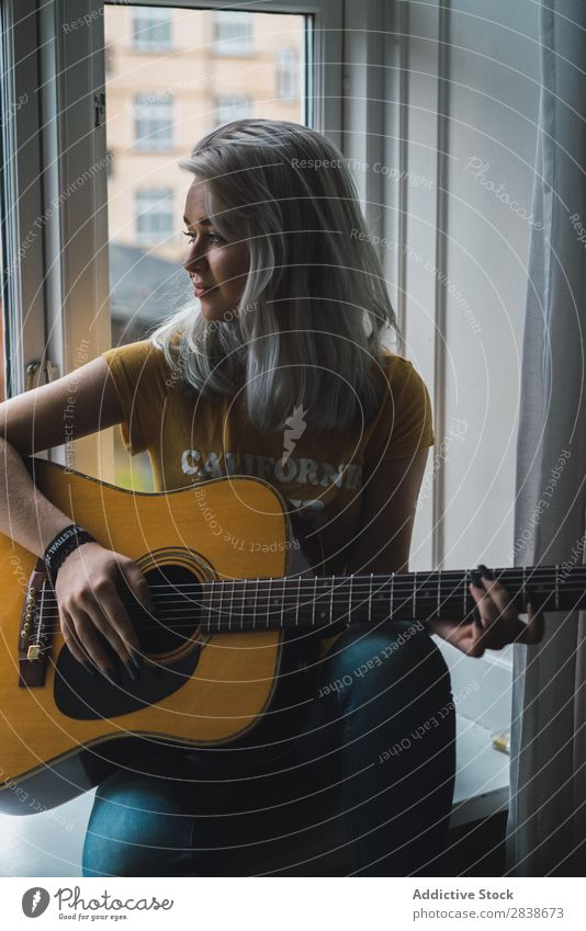 Musician sitting at window Woman pretty Home Youth (Young adults) Guitar Inspiration Playing Blonde Beautiful Lifestyle Beauty Photography Attractive