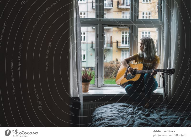 Musician sitting at window Woman Home Youth (Young adults) Guitar Inspiration Playing Blonde
