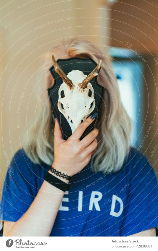 Woman closing face with skull pretty Home Youth (Young adults) Blonde Death's head Animal Decoration horns Posture Beautiful Lifestyle Beauty Photography