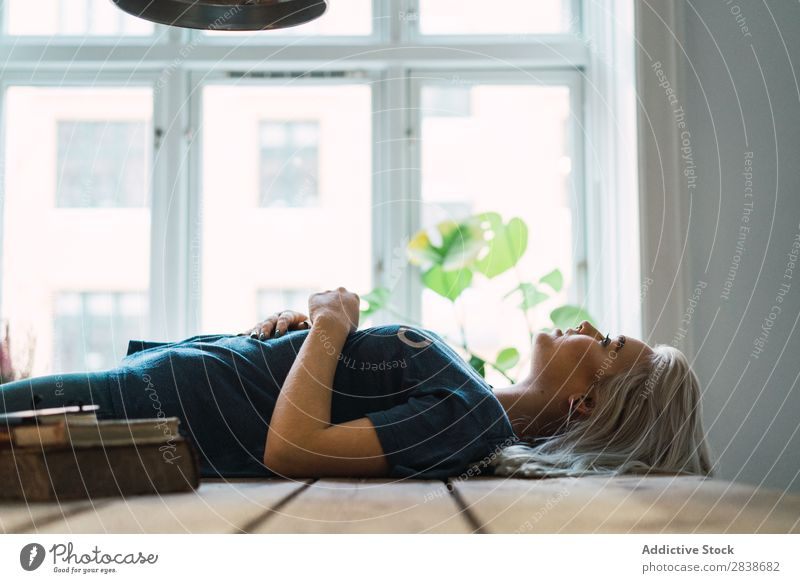 Smiling woman lying on table Woman Home Youth (Young adults) Blonde Beautiful Table Lie (Untruth)