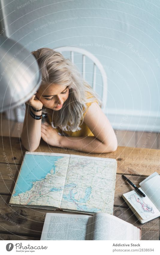 Woman watching map in book pretty Home Youth (Young adults) Blonde Sit Table Book Map Lanes & trails Beautiful Lifestyle Beauty Photography Attractive