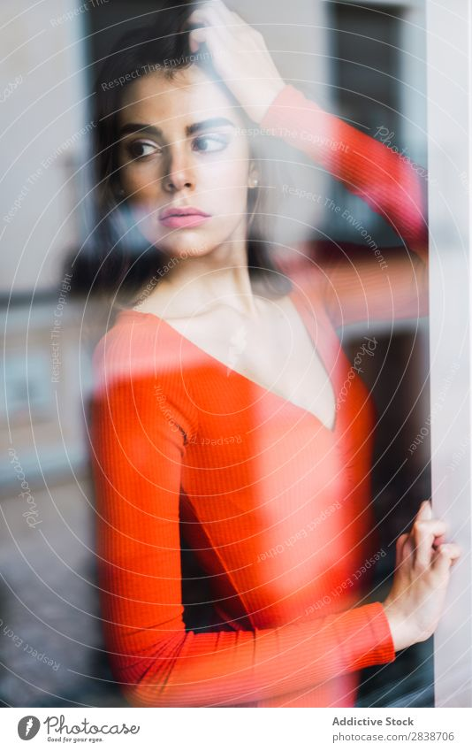 Pretty woman leaning on window Woman Home pretty Window Lean Orange Dress Youth (Young adults) Posture Relaxation Portrait photograph Beautiful Lifestyle