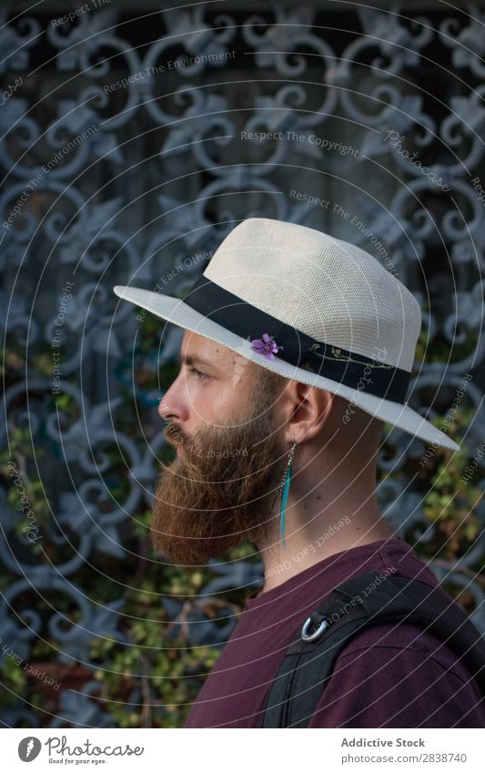 Portrait of bearded man with earring Man Brutal Earring brutality Masculine Lifestyle decor traveler Model Youth (Young adults) handsome Fashion Beard