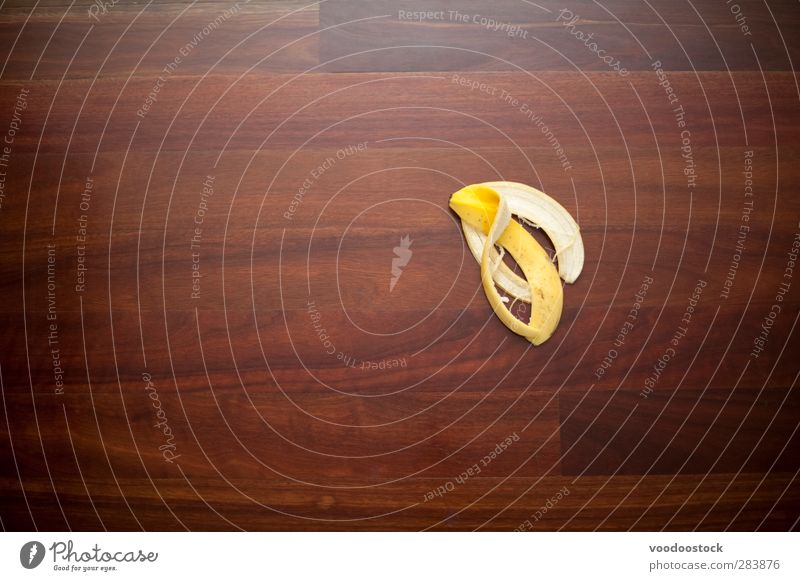 Making a Mistake or Slip-up Fruit Yellow banana skin Story Surface wood sinky peel accident risk potential danger Banana misfortune bad luck unlucky Avoidance