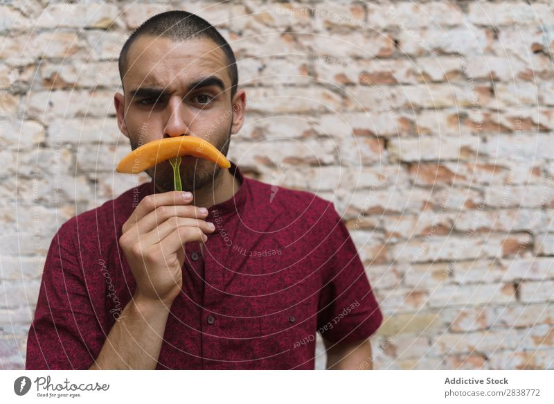 Playful man posing with fruit Man pretend Moustache having fun Fruit Replication Posture Melon Comic Humor Street Joke Youth (Young adults) Slice Grimace Joy