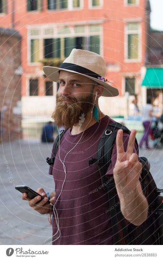 Traveler with headphones and phone Man traveler Relaxation Headphones Music Dream Backpack PDA Summer Vacation & Travel Adventure romantic Modern bearded Trip