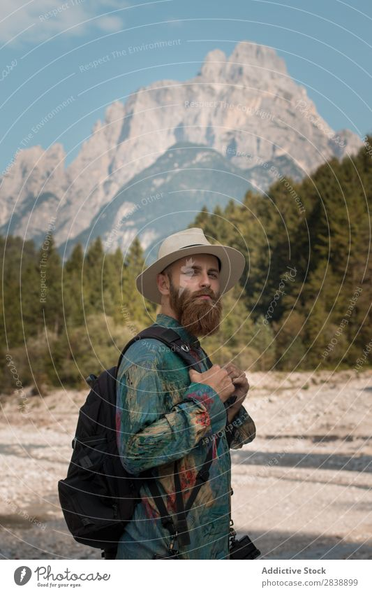 Handsome tourist in mountains Man Mountain Forest Autumn Backpack bearded handsome Hat Tourist Vacation & Travel Human being Landscape Nature Beautiful Colour