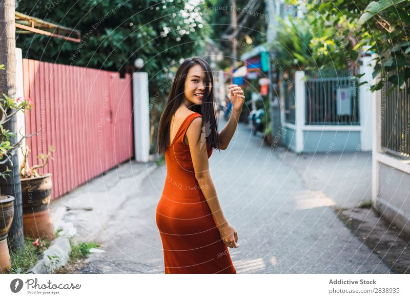 Cheerful woman posing on street Woman pretty asian Youth (Young adults) Happy Joy Street Green Town Beautiful Portrait photograph Attractive Beauty Photography