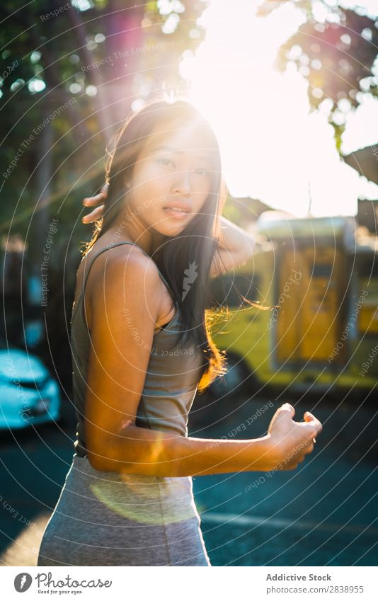 Cheerful Asian woman posing on street Woman pretty asian Youth (Young adults) Smiling Happy Joy Park Town Brunette Beautiful Portrait photograph Attractive