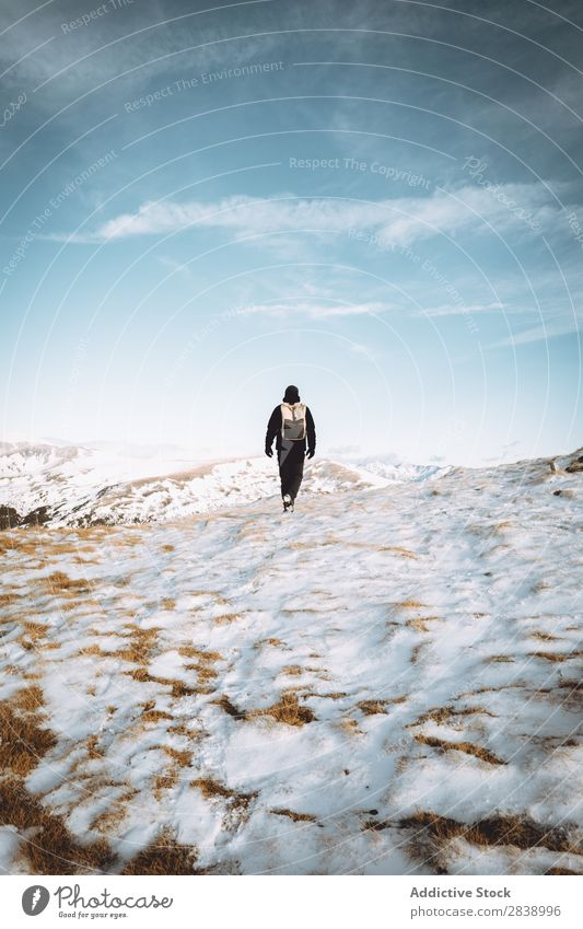 Tourist with backpack in mountains Human being Backpack Winter Hill Mountain Snow Landscape Nature White Ice Seasons Cold Vacation & Travel way Frost Freeze