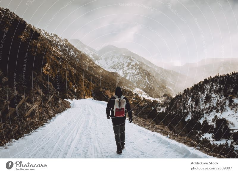 Tourist with backpack walking in mountains Human being Backpack Winter Hill Mountain Snow Landscape Nature White Ice Seasons Cold Vacation & Travel way Frost