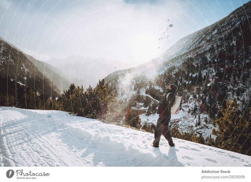 Man throwing snow up Human being Tourist Backpack Winter Hill Mountain Snow Landscape Nature White Ice Seasons Cold Vacation & Travel way Frost Freeze Weather