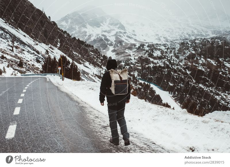 Man walking on snowy road Street Winter Hill Mountain Snow Landscape Nature White Ice Seasons Cold Vacation & Travel way Forest Frost Freeze Weather Rural