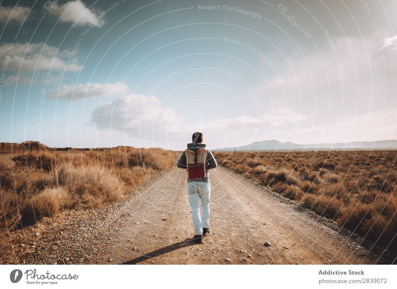 Cheerful man on dry road Human being Tourist Nature Dry Man Street Landscape Desert Landing Grass Sand Ground Environment Vacation & Travel Tourism Yellow Stone