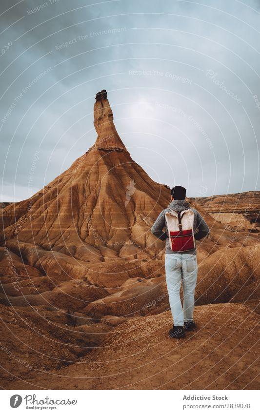 Man posing near big sandy hill Hill Mountain Nature Dry Tall Height Landscape Vacation & Travel Desert Landing Grass Sand Ground Environment Yellow Stone