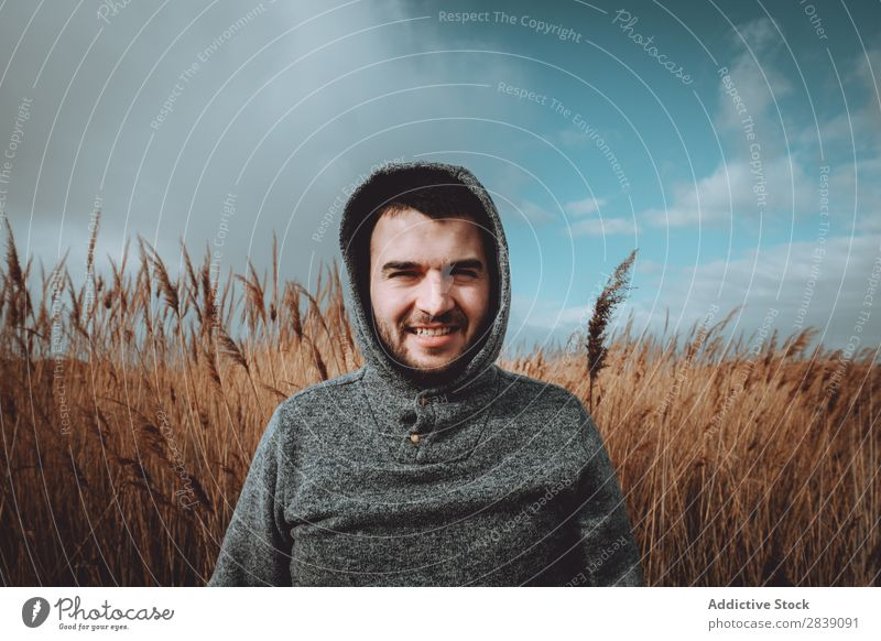 Man standing in dry grass Human being Tourist Nature Landscape Height Grass Landing Ground Environment Vacation & Travel Tourism Yellow Stone Wilderness
