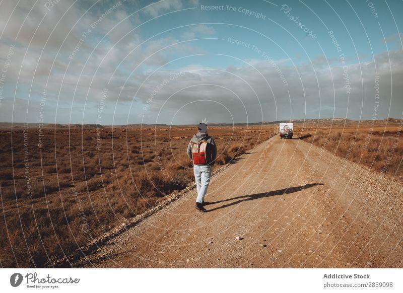 Unrecognizable man walking on dry field Human being Tourist Nature Dry Street Walking Car Landscape Desert Landing Grass Sand Ground Environment