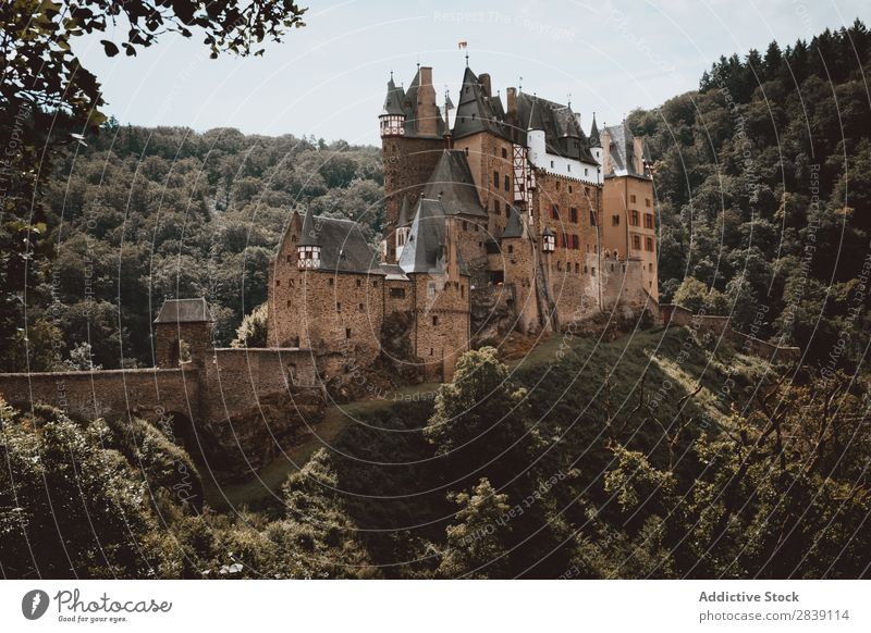 Old castle on green hill Castle Exterior Ancient Architecture castillo Eltz Alemania Historic Landmark Fortress Monument Gothic style Construction Deserted