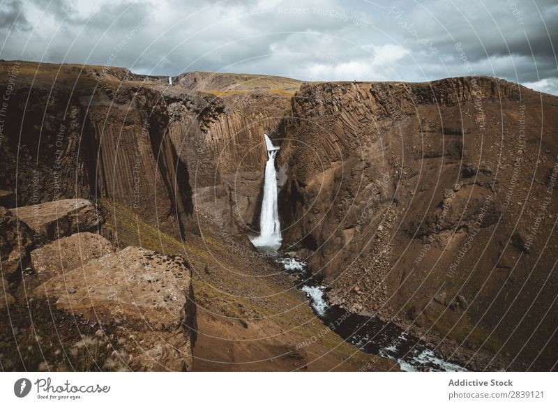Waterfall in rocky canyon Landscape Rock Islandia Canyon Flow Wilderness cascade falling Nature Fresh Beauty Photography Iceland Environment Tourism