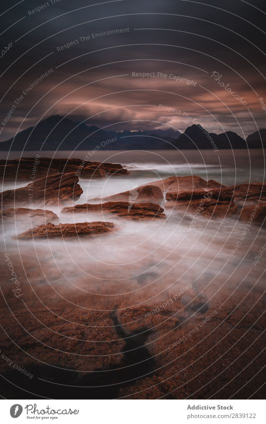 Rocks in water of sea Island darkness Landscape Elgol Majestic Dramatic Isla de Skye Escocia Nature Magic Coast Mysterious Water Vacation & Travel Scene